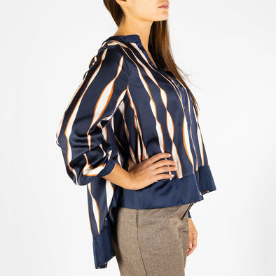 Oversized V-neck shirt with a longer hem at the back and a button fastening at the front.