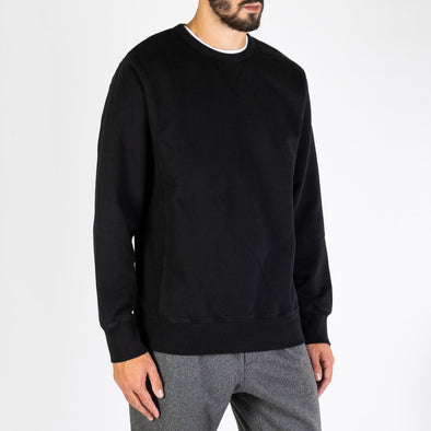Regular fit black crewneck sweater made from heavy french terry cotton.