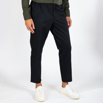 Black loose fit pants with an elastic string at the waist.