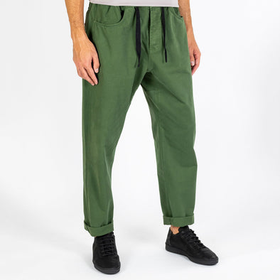 Green twill pants with baggy fit.