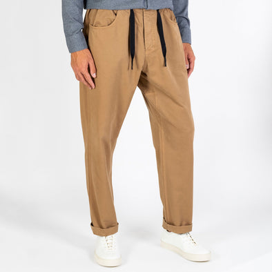 Beige twill pants with baggy fit.