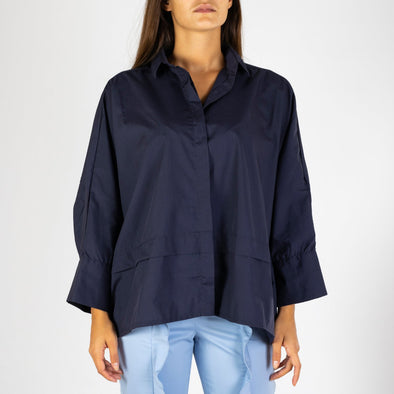 Bat winged loose shirt in navy blue.