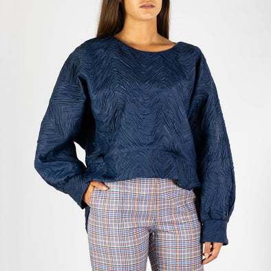 Bat winged textured sweater in navy blue.