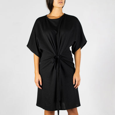 Short detailed black dress with distinct tunnel front.