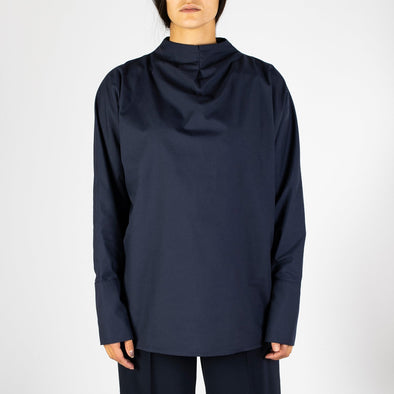 Large navy blue shirt with pleated collar.