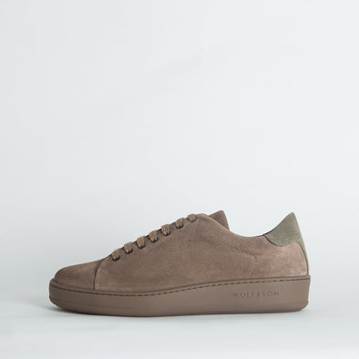 Casual suede low-top sneakers in neutral shades.