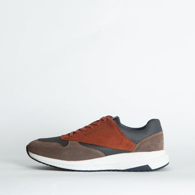 Classic-style runners in paneled rust orange and light brown suede and grey mesh.