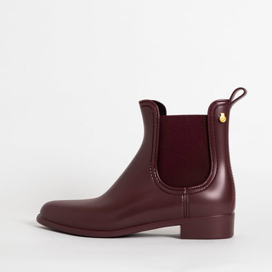 Chelsea boots in wine matte non-toxic PVC.