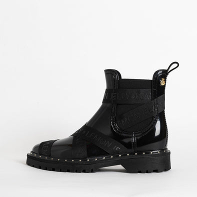Boots in black non-toxic PVC with strap details.