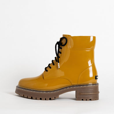 Lace-up boots in rusted gold non-toxic PVC.
