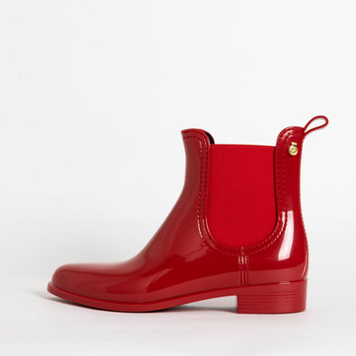 Chelsea boots in red non-toxic PVC.