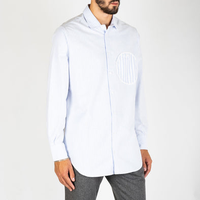 Basic light blue shirt with a distinctive round pocket.