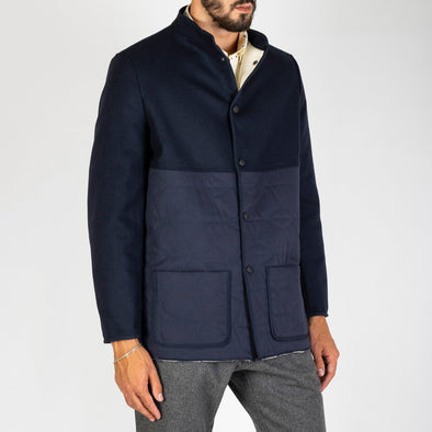 Navy blue winter jacket with two front pockets.