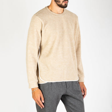 Beige cotton and wool blend knit sweater with contrasting edges.