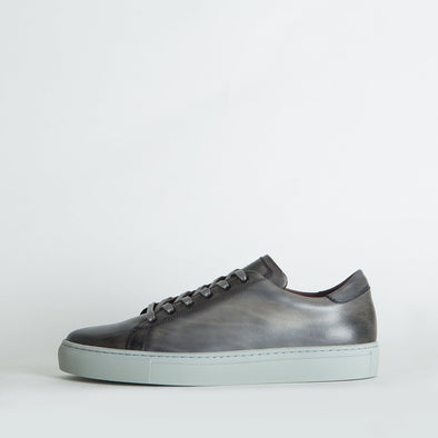 Low top sneakers in grey leather.
