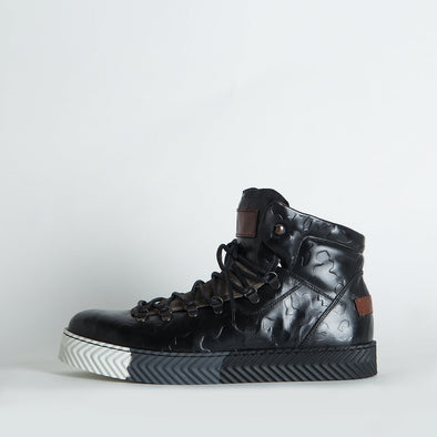 High top sneakers in black detailed leather with a distinct sole.