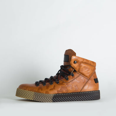 High top sneakers in brown detailed leather with a distinct sole.