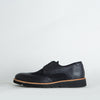 Derby shoes in black leather and suede with a detailed sole.
