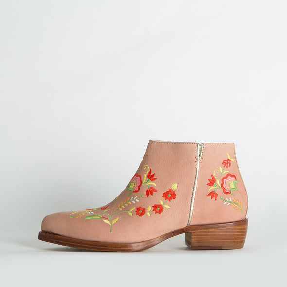 Light rose flat ankle boots with colorful floral details.