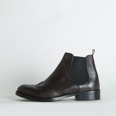 Chelsea boots in dark brown burnished leather with broguing.
