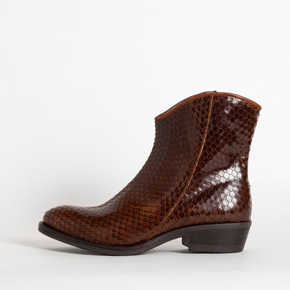 Heeled ankle boots in brown leather with texture detailing.