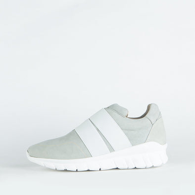 Minimalist grey sporty runners with two precise straps harmoniously overlapping the simplicity of the its shape.
