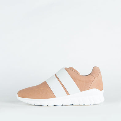Minimalist light pink sporty runners with two precise straps harmoniously overlapping the simplicity of the its shape.