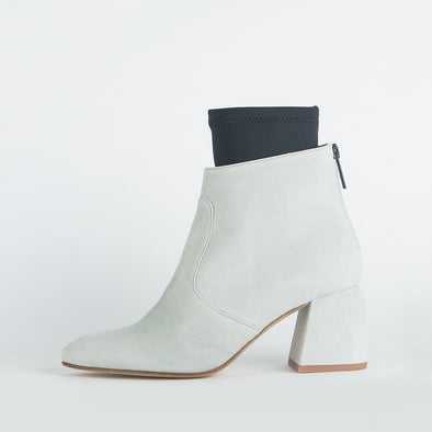 Light grey suede ankle boots with fiber leather detailing.