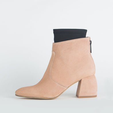 Light pink suede ankle boots with fiber leather detailing.