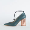 Pump heels in bottle green leather with a round copper heel.