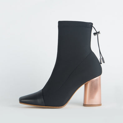 Heeled sock boots in black with pointed leather toe and round copper heel.