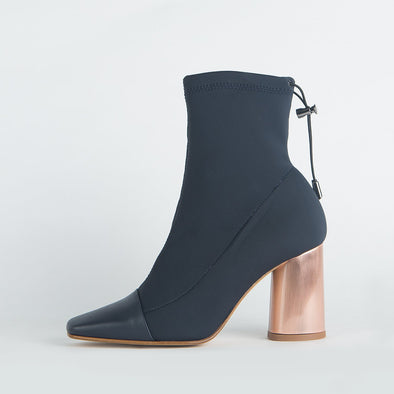 Heeled sock boots in deep blue with pointed leather toe and round copper heel.