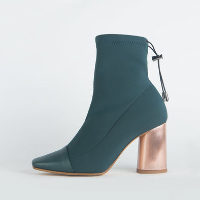 Heeled sock boots in bottle green with pointed leather toe and round copper heel.