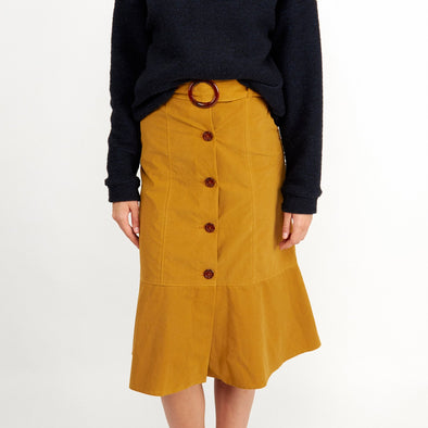 Yellow silhouette midi skirt with front buttons and belt.