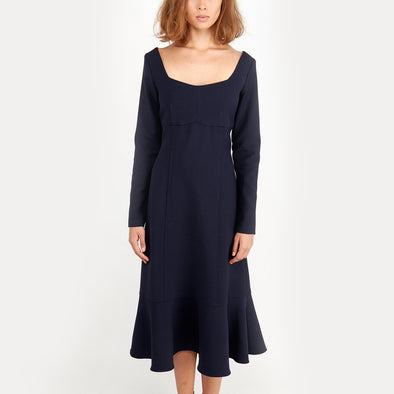Midi silhouette navy blue dress with long sleeves.