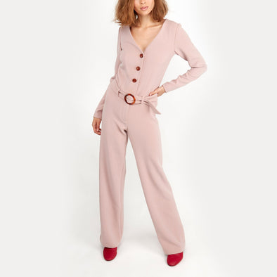 Rose long sleeved jumpsuit with buttons and belt.