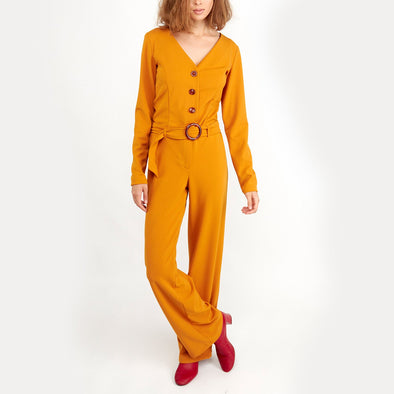 Roasted yellow long sleeved jumpsuit with buttons and belt.