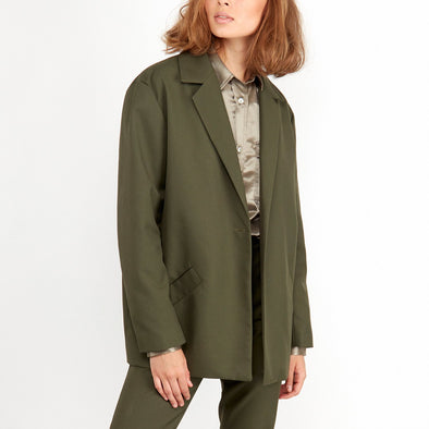 Green blazer with two front pockets.