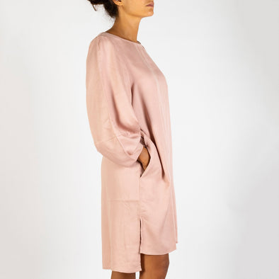 Dusty pink midi dress featuring side splits and a dropped hem.