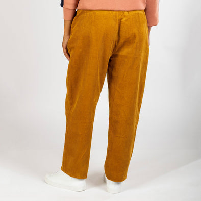 Exaggerated peg leg style pant in a mustard corduroy.