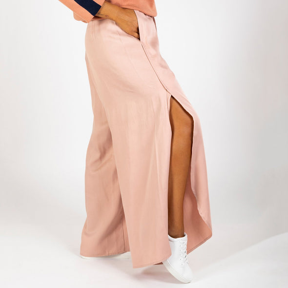 Floaty wide leg trouser with overlapping exaggerated side split and curved hem.