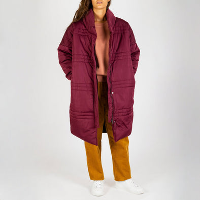 Burgundy colored long puffer jacket.