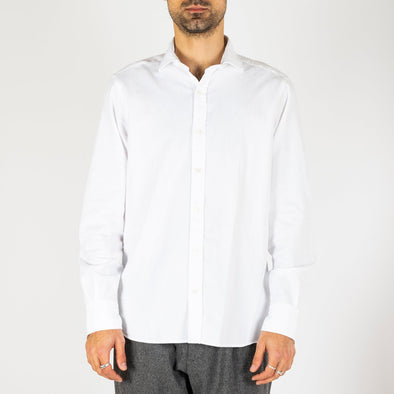 Minimalist and timeless white shirt.