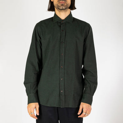 Minimalist and timeless dark green shirt.