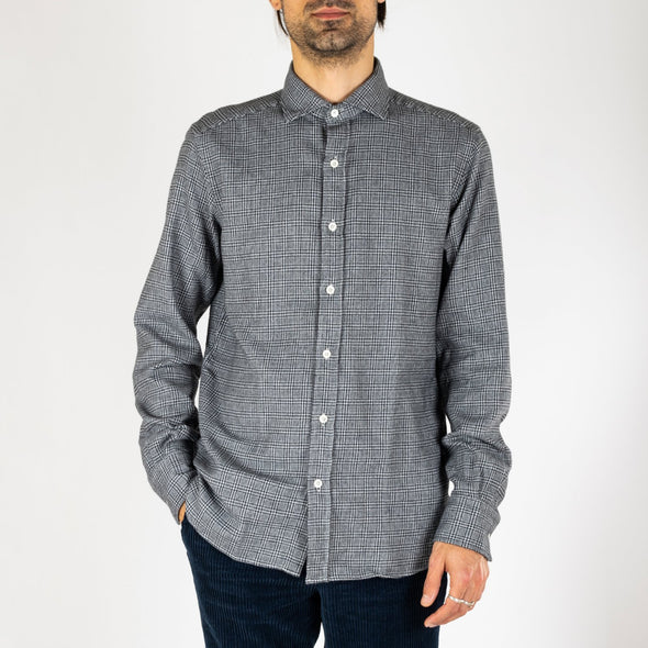 Minimalist and timeless grey shirt.