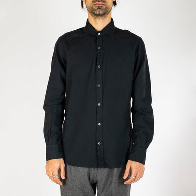 Minimalist and timeless black shirt.