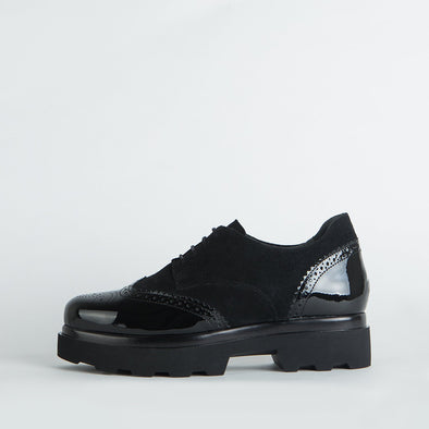 Black suede derby platform shoes with varnish detaling.