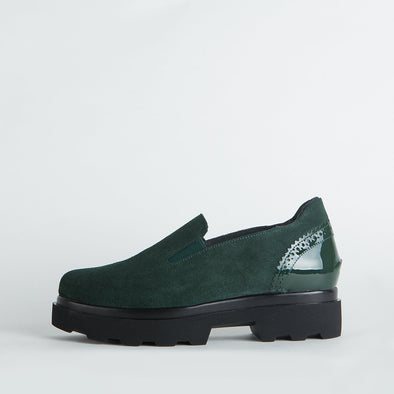 Deep green suede platform shoes with varnish detaling.