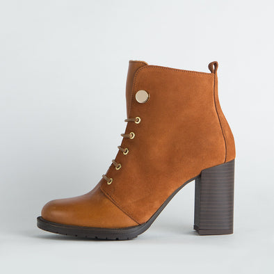 Heeled lace-up boots in brandy colored leather.