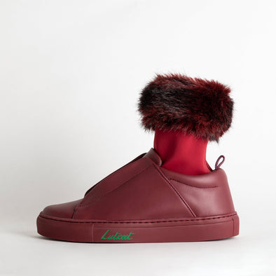 Burgundy leather sneakers with removable faux fur bracelet.